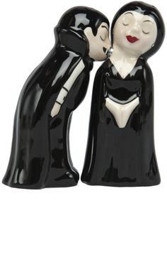 """VAMPIRE SALT & PEPPER SHAKERS    It was love at first bite for this pair here! This ceramic salt & pepper set includes a vampire, undead bride dressed in black & are held together with a pair of magnets.  3 1/2"""" tall    $10.00"""