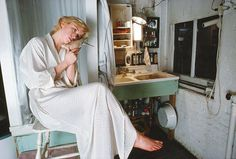 Cindy Sherman, 1982. Sherman with her blind pet dove in her apartment at 64 Fulton Street, where she lived until 1983. The shower was in the kitchen and the toilet was down the hall. // Slightly More Honest