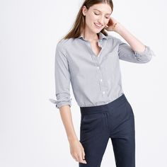 "The perfect shirt for work and beyond. Borrowed from the boys but designed and tailored impeccably for us—that's why we call it perfect—with precisely placed bust and back princess darts for a slimming, waist-defining fit that's a bit more feminine than our boy shirt. Crafted from lightweight cotton with a hint of stretch for extra comfort, this shirt is as indispensable as it is incomparable. <ul><li>Body length: 26 1/2"" (small), 27"" (medium).</li><li>Cotton with a hint of…"