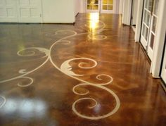 A swirled floral pattern weaves throughout the stained concrete floor serving as a durable alternative to commercial carpeting. Floor Seasons Las Vegas, NV