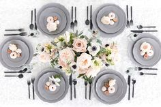 This blush and black tablescape is my all-time favorite! . Who says all fall table settings have to feature orange hues? This is stunning for brunch and you can use those gray plates for your Halloween parties!