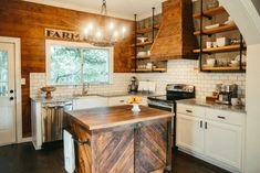 Kitchen from Fixer Upper -- Wood and Piping Industrial Shelves in the rustic remodel.