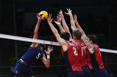 Osmany Juantorena of Italy spikes the ball against