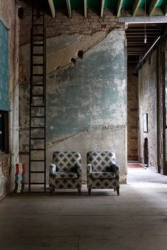 Love the idea that the decay is the art. No need for any art on the wall here. I would get different chairs. Something more modern or Herman Miller (photo by Paul Raeside)