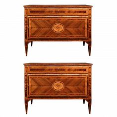 An extremely high quality and handsome pair of Italian 18th century Louis XVI period three drawer walnut inlaid commodes. Each chest is raised by four square tapered legs each decorate with charming inlays, and intricate scrolling foliate designs. Above the straight frieze, the two bottom drawers are 'sans traverse' with a stunning central floral marquetry design continuing over both drawers and set within a quarter veneered panel and wood fillet frame. The same rich pattern is repeated at…