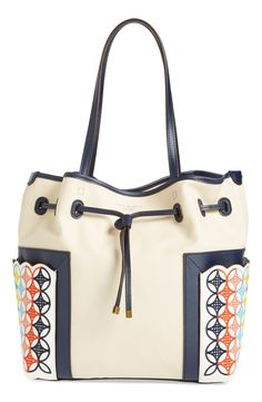 Love the laid back vibe from this embroidered Tory Burch bucket bag.