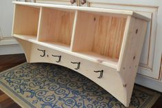 Here is a versatile and stylish storage shelf with coat hooks and storage cubbies for organizing all of your outdoor gear. The shelf can be