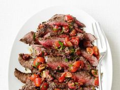 Use a grill or grill pan to cook flank steak and serve with a fresh tomato salad.