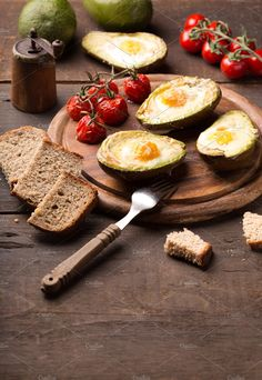 baked avocado with egg by peterzsuzsa on @creativemarket