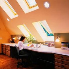 The intersection between the sharply pitched ceiling and the low wall of this attic provides a perfect spot for a long built-in desk that functions as a craft center. Attic Renovation, Attic Remodel, Attic Rooms, Attic Spaces, Attic Playroom, Attic Bathroom, Attic Office, Attic Loft, Attic Library
