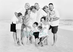 fun, large family shot - love the feeling of touch and family, not just the perfect smiles at the camera (i would choose different colors but LOVE this idea!!)