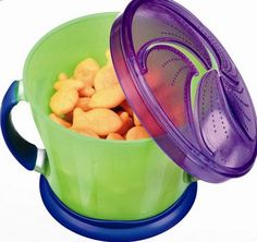 Munchkin brand snack holder for gold fish, cheerios, etc. Best part of this it doesn't spill out once the top part is on.