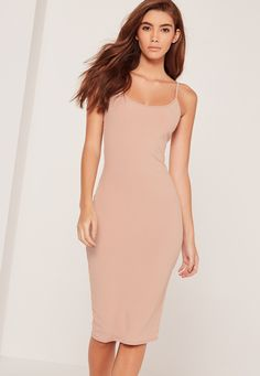 Minimal effort but maximum vibes are where it's at and this midi dress in a sandy nude hue with pink undertones and strappy deets is a sure fire way to give your curves the attention they deserve.