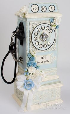 I designed this handmade chipboard pay phone box initially for the blue Easter Greeting papers, but I couldn't resist making another one after seeing the lovely Scent of Lavender colors!  Whi…
