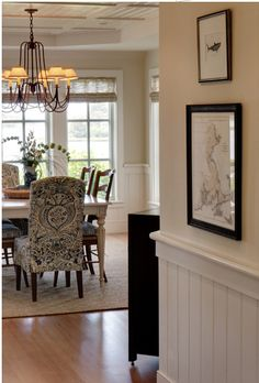 Paint a neutral color above white beadboard wainscoting in the ...