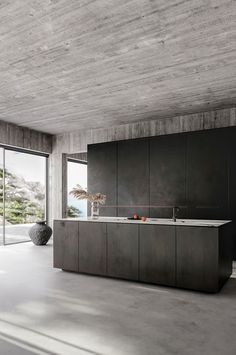 Contemporary interior design, minimalistic decor, bare concrete walls, concrete floors, minimalist black kitchen. Design by Klaudia Adamiak