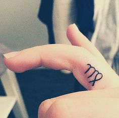 Tiny Finger Tattoo Ideas | POPSUGAR Beauty