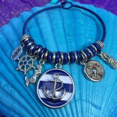 A personal favorite from my Etsy shop https://www.etsy.com/listing/248487480/mermaid-charm-bracelet-anchor-bracelet