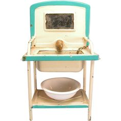 """Antique German Dollhouse Enameled Tin Washstand with Water Reservoir Early 1900s 1"""" Scale..Nice looking antique German dollhouse enameled tin washstand is painted cream with turquoise blue trim. It has a deep sink with towel bars.."""