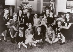 Franklin and Eleanor Roosevelt with their thirteen grandchildren in FDR's White House study. Portrait taken by Navy photographers on Inauguration Day, January 20, 1945.