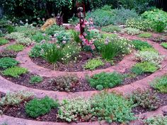 not even sure how this is paved - concrete with stamped designs, or individual pavers? succulents and other perennials in a variety of forms and textures give it a cottage garden look and feel