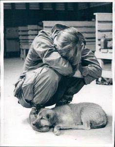 A weary GI and his pup take a brief respite from the war as they catch up on sleep at a staging base at Quang Tri February 5, 1971, before being airlifted to Khe Sanh.UPI from files PHOTO BY TOSHIO SAKAI 11-2-72