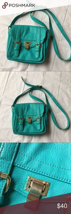 """Steve Madden Teal Crossbody Bag Small Has some wear on exterior (metal hardware has a few scratches, wear on corner of bag). Inside could be cleaned out. Measures approximately 8 x 8 x 3."""" Strap drop currently at 23."""" Faux leather. Smoke-free home. Steve Madden Bags Crossbody Bags"""