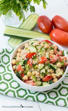 This cucumber tomato quinoa salad is the perfect, filling salad to enjoy on a warm summer afternoon. It is vegan, gluten free and so simple to assemble!