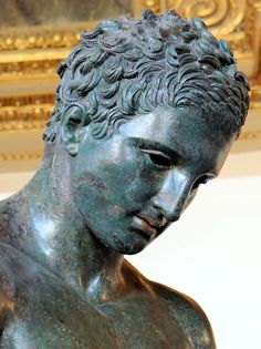 """The Croatian Apoxyomenos, (the """"Scraper"""") discovered in the Adriatic Sea near Croatia in 1996 fully covered in sponges and sea life. The statue is currently thought to be a Hellenistic copy of Lysippos' Apoxyomenos from the second or first century BCE.The scraper is one of the conventional subjects of ancient Greek votive sculpture; it represents an athlete, caught in the familiar act of scraping sweat and dust from his body with a strigil."""