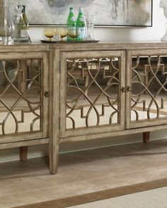 I like the mirrored furniture look. | Braxton Sideboard at Neiman Marcus.