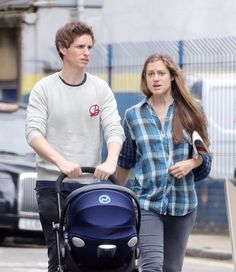 "bespokeredmayne: ""Meet the Redmayne family…In this first glimpse, Eddie, Hannah and baby Iris Mary are out for a stroll. "" BABYMAYNE!"