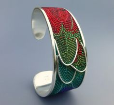 Red and Green Macaw Cuff Bracelet - micro-mosaic jewelry in sterling silver, glass seed beads, grout by Courtney Denise Lipson. www.CDLjewelry.com