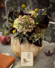 Fall wedding centerpieces with seasonal flowers and Fruits
