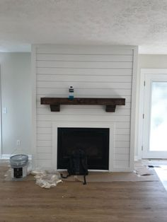 My husband and I recently fixed up a house. We wanted to added something fun to the living room to make it more attractive. So, we decided to shiplap the firepl… Basement Fireplace, Brick Fireplace Makeover, Shiplap Fireplace, Farmhouse Fireplace, Home Fireplace, Living Room With Fireplace, Fireplace Surrounds, Fireplace Design, Fireplace Mantels