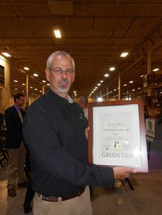 Visual Impressions COO Marshall Atkinson with the newly earned Wisconsin Green Tier certificate for sustainability