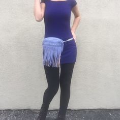 Periwinkle Fringe Studded Fanny Pack Belt Bum Bag Faux leather fringe convertible bag in the most gorgeous shade of periwinkle blue! It has 2 belt loops in back and a removable chain. You can wear it as a fanny pack, cross body, or shoulder bag. In the photo I am using the chain as a belt. If you would like to use the chain as a belt too, please let me know your waist size when you check out. Thank you for looking! Bags Crossbody Bags