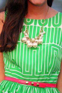 Pearl necklace + green dress + coral belt. Classy Girls Wear Pearls.