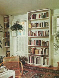 bookcases on recessed plinth bases which raise them off of the floor
