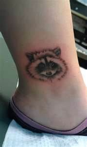 Maybe a Raccoon to match Angel's tattoo??
