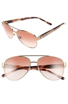 Who doesn't love rose gold accessories? The check-patterned temples add just the right amount of sophistication to these chic Burberry aviator sunglasses.