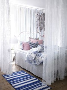 Divide a big room into two by hanging ALVINE SPETS curtains around your bed.