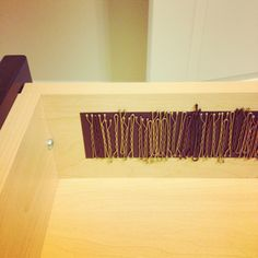 Magnetic strip for bobby pins on side of drawer.