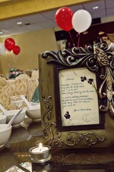 """""""I wrote up my favorite quotes about love and marriage and stuck them in thrifted frames for our centerpieces because I'll always be more at home amongst words than flowers.  What keeping a sense of the everyday in our wedding means now, nearly two months later, is that reminders of the wedding are scattered everywhere in our everyday life.  We've hung up the centerpiece frames all over our new apartment."""" (A Practical Wedding)"""