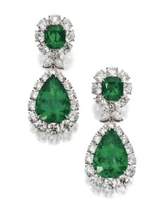 Pair of emerald and diamond pendant earclips. The tops set with 2 cushion-shaped emeralds weighing 3.77 and 3.90 carats, the pendants with 2 pear-shaped emeralds weighing 19.00 and 19.65 carats, framed by 44 round diamonds weighing a total of 24.69 carats, and joined by 4 pear-shaped diamonds weighing 1.54 carats, mounted in platinum.