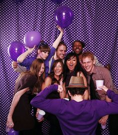 Use a white on purple polka dotted fabric for a partyworthy photobooth backdrop