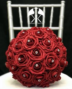 RED Flower Ball with BLING RHINESTONE GEMS. 12 Flower Ball is pictured with Rhinestone Gems.  RED Flower Ball made with PREMIUM Real Touch Roses. Add Bling Rhinestone Gems in roses or Pearl Brooches between the roses to add a little more bling to your special day! You will be amazed at how real and Flower Ball Centerpiece, Red Wedding Centerpieces, Bling Centerpiece, Mickey Centerpiece, Quinceanera Centerpieces, Red Flower Girl, Flower Girl Bouquet, Red Flowers, Red Corsages