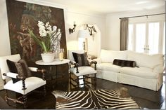 great look and ideas for a small room -- amazing how the super large art adds so much to room, ditto the zebra rug & beautiful orchid --  3 pieces to make a room fabulous
