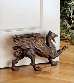 The Growling Griffin Foundry Iron Doorstop. My mother's family's coat of arms features a griffin rampant.