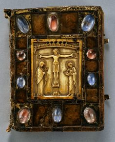 Small Bernward Gospel, German (Hildesham) late 12th century. Gilded copper, rock crystal, paint on parchment under horn on oak. Byzantine ivory plaque.