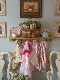 cute way to display vintage aprons